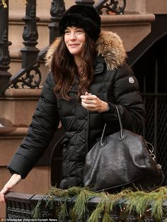 09eb89c9626 Keeping warm  The actress fought off the cold with her black Moncler  Salsifis down coat
