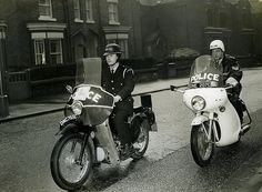 A Manchester City Police cadet under motorcycle riding instruction on the roads of Manchester in 1966.     The cadet rides one of the classic British police motorcycles of the era, the Velocette LE. The model, nicknamed the Noddy Bike, was hugely popular with police forces across the country in the 1950s and 1960s. http://www.gmpmuseum.com