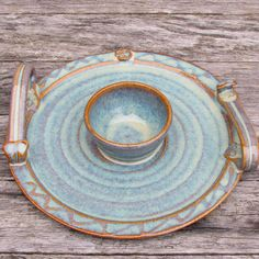 - Measures 9 inches diameter with center dip bowl - Classic design handles with spiral stamp - Part of Glas Collection. Glas is the Gaelic word for green - Glazed in high temperature kiln oven for dur