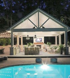 Outdoor kitchen pool house at night with bistro lights. Outdoor kitchen pool house at night with bistro lights. Pool House, Outdoor Rooms, Patio Design, Pool Houses, Outdoor Kitchen Design, Outdoor Fireplace, Large Backyard, Pool House Designs, Dream Backyard