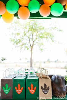 dinosaur themed birthday party. Table decoration. goody bags