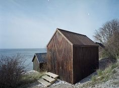 """beach cabins in Gotland by Sandell Sandberg """"The pine facade panels were treated with a tar and linseed oil varnish, a traditional Swedish treatment for houses built near the sea. Cabana, Scandinavian Cabin, Dock House, Bothy, Cabins And Cottages, Small Cabins, Small Buildings, Cabin Design, Facade House"""
