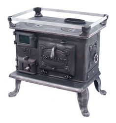 ship stove for a tiny house / little cod marine stove little cod stove @ sackville, NB foundry: http://www.renewsing.com/2010/08/15/wood-heat-hot-water-the-story-behind-our-little-cod/ http://2cycle2gether.com/2010/08/wood-heat-and-hot-water/#.VI6Z9SeQzZs