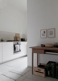Simple, stylish white kitchen with wood accents