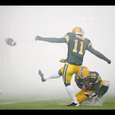 Quarterback Matt Nichols holds as Grant Shaw kicks the point after as the Edmonton Eskimos battle the Calgary Stampeders in the final game of the regular season at Commonwealth Stadium in Edmonton, Alberta on Nov. 2, 2012. Photo by Bruce Edwards/Edmonton Journal #esks #cfl #football #snow #fog #yeg