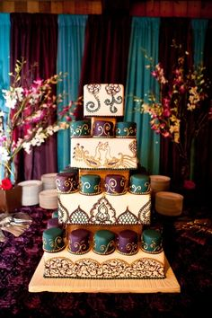This cake was inspired by our Sarah invitations which was custom designed for our bride Sarah Das.