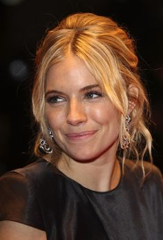 Sienna Miller Loose Bun - Sienna Miller wore her hair in a teased, loose bun with center-parted bangs for the BFI London Film Festival.