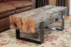 2 beamed coffee table. Steel cradle with 180 year old beams