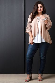 This plus size cardigan features a textured woven fabric, open front constuction, and elbow sleeves fit with crochet scallop-ended design. Finished with a high-low hemline. Accessories sold separately