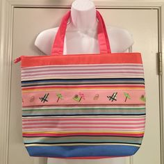 Multi-Striped Summer Tote Super cute tote is multi stripped in pastel colors with beach icons Very sturdy canvas tote is lined and has a large zip pocket inside as well as an open smaller pocket Zips close at the top with straps measuring 10 inches from the top of tote Never got around to using it NWT Bags Totes
