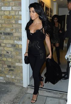 Hot mama! Kourtney Kardashian looked ready to take London by storm on Monday evening as she stepped out in a racy outfi
