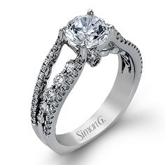 Runway Collection - This gorgeous 18K white gold ring is comprised of .91ctw round white Diamonds. - MR2248