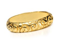 Georgian Ornate Eternity Ring. Very deep engraving characterizes this solid 18k yellow gold Georgian eternity ring wedding band. Floral motifs typical of this period usually incorporate flowers and leaves in pattern form. Such designs cover the entire antique surface of this period finger ring. Circa 1830