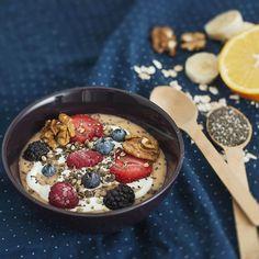 Walnuts, orange juice, banana, raspberries, Greek yogurt, blueberries, oats, hemp seeds, chia seeds, peach, blackberries and strawberries smoothie