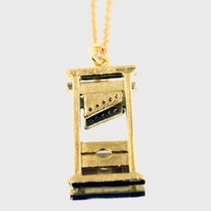 COOL!  Guillotine Necklace, now featured on Fab.