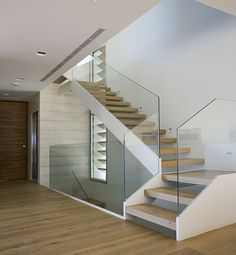 Increase light and space in small houses by changing stair angles and using glass