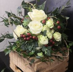 White roses, spray roses, and succulents with a touch of the warm red hypericum berry for a Christmas time wedding. Love the texture and natural look of the trailing ivy and eucalyptus. Winter Christmas, Christmas Wedding, Christmas Time, Wedding Flowers, Wedding Day, Spray Roses, Natural Looks, Bridal Bouquets, Winter White