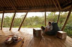 """Upstairs, Evans' office consists of a laptop and a beanbag overlooking the forest. """"Living here is like a dream,"""" he says. """"The design of my house really allows me to experience all of nature up close.""""- tropical bedroom by Jeni Lee"""