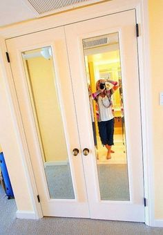 Placing some framed mirrors on closet doors can add more purpose, and help the room feel spacier.