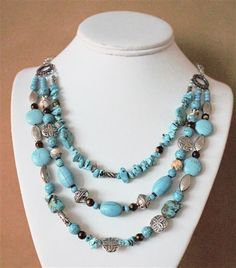 This necklace is stunning and beautiful. Perfect for any outfit or occasion.<br/><br/>I used brown miracle beads, multi color agate, Tibetan silver and Turquoise chips to accent the turquoise chunks and coins.<br/><br/>As with all my jewelry, this necklace is one of a kind and will be this one that is send to you. I can do a similar necklace in two strand also.