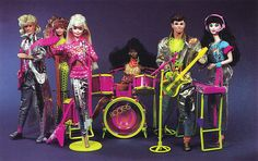 Barbie and the Rockers. This was thee coolest barbie set growing up. I especially liked the blonde guy with the big mullet and reflective silver outfit