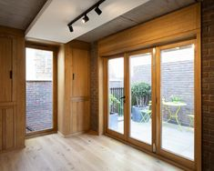 The wall is visible from within the homes and in the kitchen, it has been left exposed. London Townhouse, London House, British Architecture, Amazing Architecture, Timber Windows, Oak Panels, Minimal Home, Zaha Hadid Architects, House Elevation