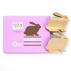 """Enormouschampion rabbits, set of two. Although they're made from sturdy solid wood, Animalia are not toys and may break if dropped. Made in the USA from sustainably harvested wood. Laser cut. Hand finished. Stained and painted with non toxic, no-VOC water-based stain and paint and finished and sealed with beeswax. Each rabbit measures 4.75"""" x 6"""". $44"""