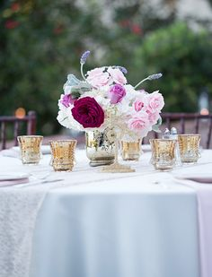 Hydrangea, lavender, & roses in golden urn. (Flowers by Lee Forrest Design, photo by: Tab McCausland Photography)