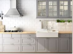 This is more or less what we will have: the grey cabinets, but still not sure about the counter top if we will have wood or stone... We do want the white subway tiles with white grout.