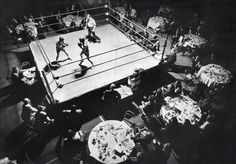 "April 15, 1970: ""An assembly of 300 attended a charity buffet dinner that concluded with seven bouts between amateur boxers representing teams from New York and Chicago in the newly conceived International Boxing League,"" reported William N. Wallace. The Amateur Boxing Gala dispensed with tuxedos and included the participation of female boxers, including the sister of a Giants fullback and the date of a Giants halfback. Photo: Larry C. Morris/The New York Times"