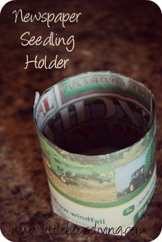 How to make seedling holders out of old newspaper! Easy and you can stick the whole plant and planter into the ground!