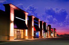 Modern Strip Mall at Night - F4photographystudio.com Colorful Imagery Retail Facade, Shop Facade, Building Facade, Mall Design, Store Design, Royalty Free Pictures, Royalty Free Stock Photos, Retail Architecture, Strip Mall