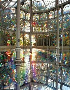 """The Palacio de Cristal (""""Crystal Palace"""") is a glass and metal structure located in Madrid's Buen Retiro Park. It was built in 1887 to exhibit flora and fauna from the Philippines. Although it is no longer used as a botanical garden, it now houses art exhibits.  CruiseHolidaysNJ.com - Marlboro NJ (800) 284-2784"""