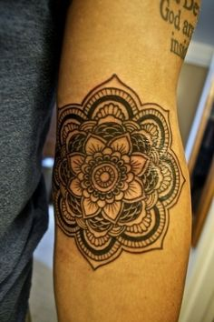 elbow flower mandala upper abs tat think about tiger lilly
