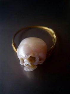 Carved pearl skull ring. Simple. Horrifying. Momento mori.