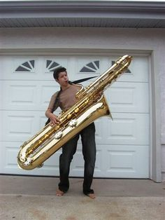 Bass Saxophone - didn't fit in home studio? HUMOR PIC by #cSw:)  has become a MOST POPULAR RE-PIN, https://www.pinterest.com/DianaDeeOsborne/ddo-most-popular-re-pins/ - as we smile at the humor of this man struggling to be physically fit as he holds on to his musical instrument & simultaneously plays music with skill! Quite a double task!