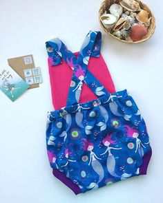 Mermaid summer playsuit dungarees! A great gift for a baby & a wonderful addition to a kids outfit. These comfortable child / toddler summer romper dungarees are designed to be a loose fit for ease of movement with no restrictions. The baby dungarees are roomier in the seat, so great for cloth bums and disposables alike. In this playful outfit your baby, toddler or child is sure to stand out from the crowd. All seams are overlocked for extra strength and finished to a very high s...
