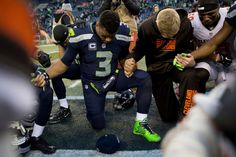 Seahawks' Russell Wilson prays in a circle with teammates and Browns players following the Seahawks 30-13 win over the Browns at CenturyLink Field in Seattle on Sunday, Dec. 20, 2015. Photo: Grant Hindsley, SEATTLEPI.COM / SEATTLEPI.COM