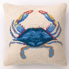A wool hand-hooked pillow adds texture, and the colorful crab brings the fun factor. | $31