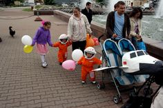 Cosmonauts- Baby carriage costume parade in Russia