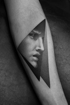Dotwork style sculpture face tattoo on the left inner forearm. Tattoo Artist…
