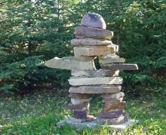 "Saw alot of these along the highways in Canada. My garden needs one! Mysterious stone figures known as inuksuit, means ""in the likeness of a human"" They are monuments made and used for communication The traditional meaning of the inukshuk is ""You are on the right path."""
