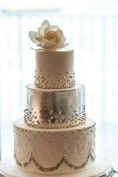 Classic white wedding cake with a metallic silver middle tier - so glamorous