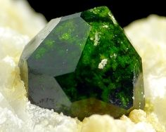 Iran. Andradite. This is a member of the Garnet family of minerals and the variety is called Demantoid. This specimen is from Belqeys Mountain, Takab in Iran and is a beautiful example of the kind of mineral specimens that are now beginning to appear in the West now that Iran is rejoining the world community.