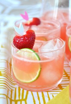 Strawberry Watermelon Cooler: 4 oz. Vodka, 1 oz. Strawberry Liquor (any berry or pomegranate works), juice of 1 lime plus slices for garnish, 1 pound watermelon chunks, 2 cups ice plus more for glasses, strawberries for garnish, Blend ingredients until frothy.