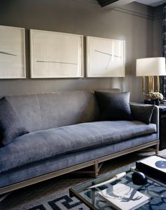 Stunning yet so simple velvet grey couch.