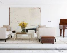 Modern-Mix Living Room.  I think that the modern white sofas sit beautifully among the clean, refined antiques.