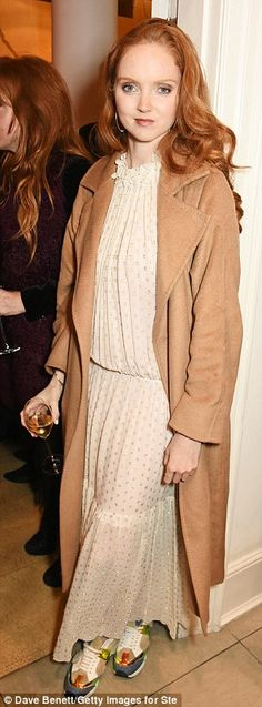 Lily was going for a more relaxed look in a floaty number after arriving in a camel coat