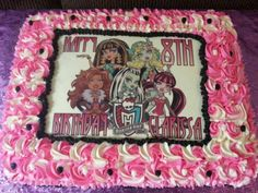 Monster high cake with pink rosettes.