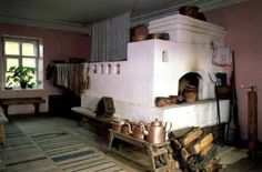 The original, old school Russian stove with a sleeping loft on top.